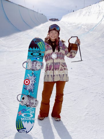 Chloe Kim poses for a photo after a first place finish