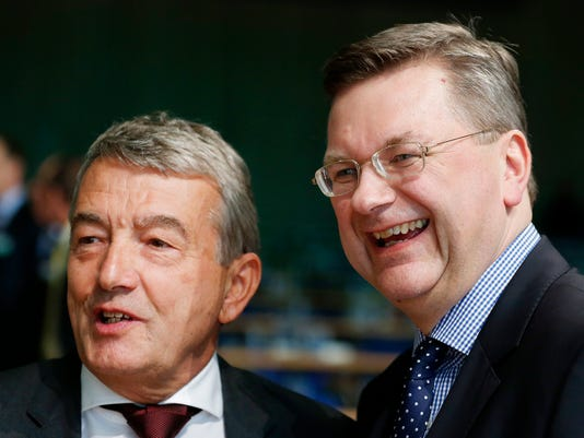 New elected President of German Soccer Federation Reinhard Grindel, right, poses with his predecessor Wolfgang Niersbach after a meeting of the German Football Federation DFB in Frankfurt, Germany, Friday, April 15, 2016. (AP Photo/Michael Probst)