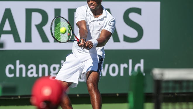 Donald Young returns the ball to fellow American Sam Querrey on Stadium 3 at the Indian Wells Tennis Garden on Sunday, March 12, 2017 during the BNP Paribas Open.