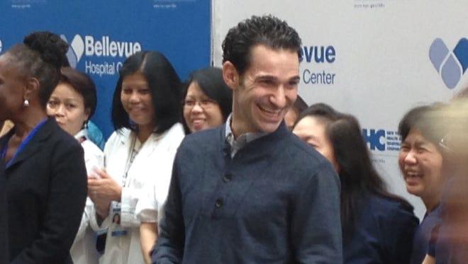 Craig Spencer, center, leaves Bellevue Hospital in New York.