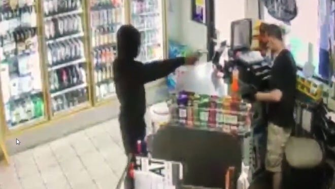 The Escambia County Sheriff's Office has released video of a suspect accused of robbing a convenience store in Cantonment on Monday, May 28, 2018.