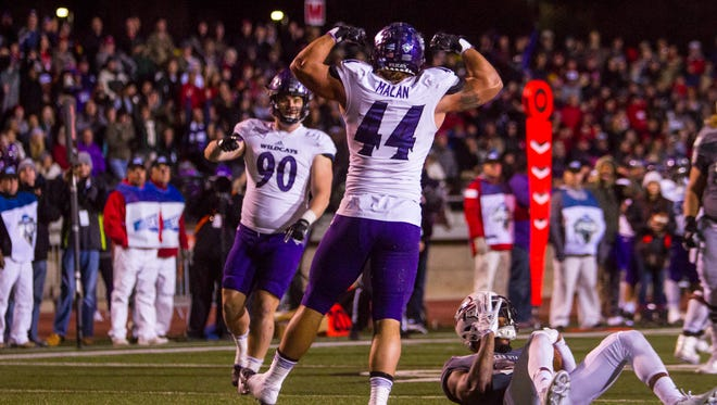 Weber State defensive lineman Carson Malan (44) celebrates a sack during Saturday's FCS playoff game against Southern Utah, December 2, 2017, in Cedar City, Utah. Weber State defeated Southern Utah 30-13.