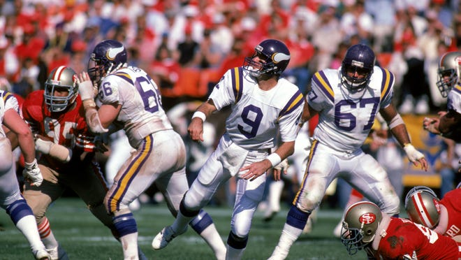 SAN FRANCISCO - OCTOBER 12:  Quarterback Tommy Kramer #9 of the Minnesota Vikings safely throws a pass under the protection of his offensive linemen Dennis Swilley #67 and Terry Tausch #66 during a game against the San Francisco 49ers at Candlestick Park on October 12, 1986 in San Francisco, California.  The Vikings won 27-24.  (Photo by George Rose/Getty Images)