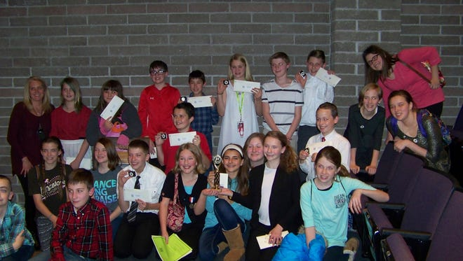 Nixa Middle School students display their awards and trophies at the National History Day Contest at Missouri State University Friday, February 26. Winners in the top three places of each category move on to the state competition in Columbia in April.