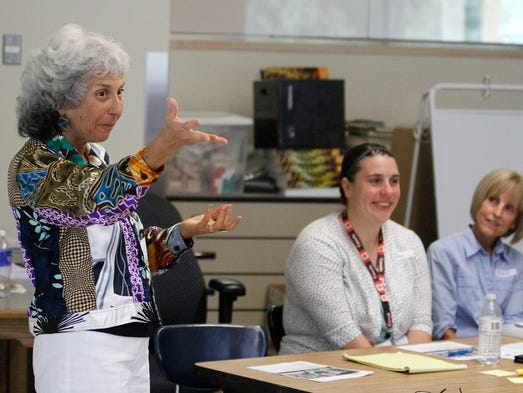 Joanne Durham, left, with Schoolwide, Inc., talks about teaching literacy with Salem teachers attending training for Common Core state standards at Battle Creek Elementary School on Tuesday, Aug. 12, 2014, in Salem, Ore.