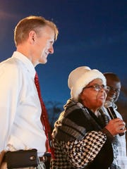 Pendleton Mayor Frank Crenshaw, left, stands with Juanita Webb, middle, counting down with her friend General Gambrell and the crowd during the Christmas Tree Lighting on Friday in Pendleton.