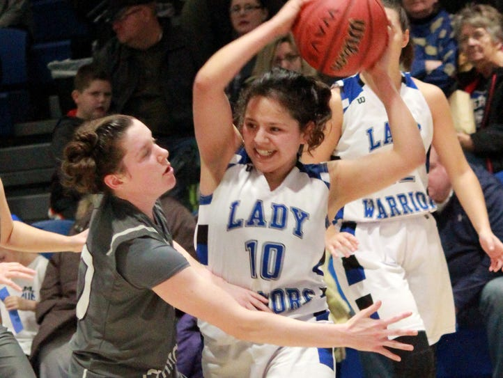 Cotter's Hanny Garay is defended by Izard County's