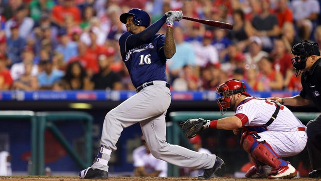 Domingo Santana follows through on an RBI single in the third inning. He also had a clutch tun-scoring single in the ninth inning.