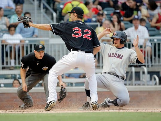 El Paso pitcher Colin Rea covers home plate as Tacoma's John Hicks scores on a wild pitch Wednesday.