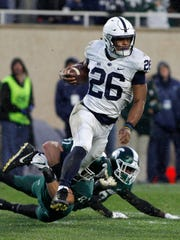 Penn State's Saquon Barkley (26) is stopped by Michigan State's Matt Sokol on a punt return during the first half of an NCAA college football game, Saturday, Nov. 4, 2017, in East Lansing, Mich. (AP Photo/Al Goldis)