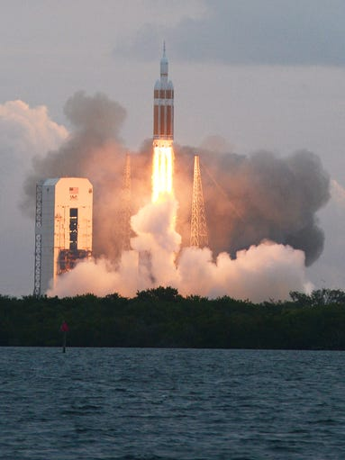 A Delta IV rocket lifts off from Cape Canaveral Air