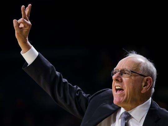 Syracuse head coach Jim Boeheim signals to players during the first half of an NCAA college basketball game against Notre Dame on Wednesday, Jan. 22, 2020, in South Bend, Ind. Syracuse won 84-82. (AP Photo/Robert Franklin)