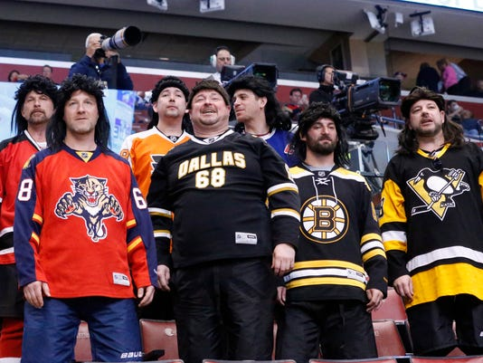 Fans of Florida Panthers right wing Jaromir Jagr look on during warmups before an NHL hockey game between the Panthers and the Montreal Canadiens, Saturday, April 2, 2016 in Sunrise, Fla. (AP Photo/Wilfredo Lee)