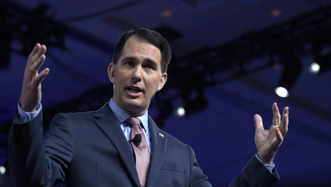 Gov. Scott Walker is urging lawmakers to overhaul the state's health insurance program for its workers. Here Walker speaks at the Conservative Political Action Conference in Oxon Hill, Md., in February.