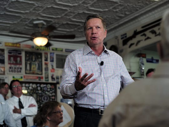 Ohio Gov. John Kasich talks during a town hall meeting