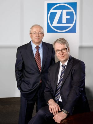 TRW President and CEO John Plant, left, and ZF Group CEO Stephan Sommer.