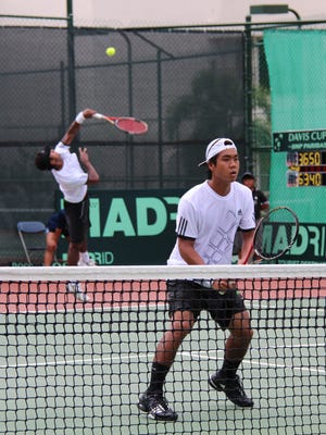In this file photo, Guam's Danny Llarenas, in his Davis Cup by BNP Paribas debut playing for Pacific Oceania, tracks his opponents' movement as doubles partner Cyril Jacobe of Vanuatu serves during a Group II tie against I.R. Iran in 2011 at the Hilton Guam Resort & Spa tennis courts. Llarenas has been selected to play in Guam's debut in the Davis Cup by BNP Paribas in Oman in January.
