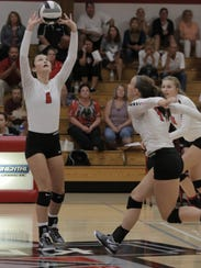 Mollie Bartlett (6) sets a ball during Lourdes Academy's