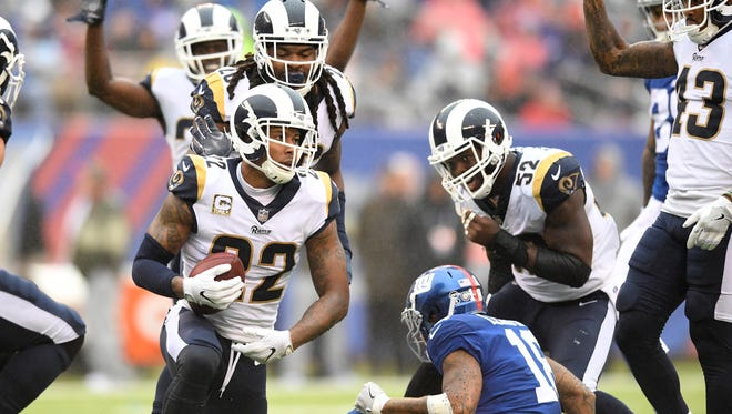 Los Angeles Rams cornerback Trumaine Johnson (22) intercepts a pass intended for New York Giants wide receiver Roger Lewis (18) in the second half. The Los Angeles Rams lead the New York Giants 27-10 at the half on Sunday, November 5, 2017 in East Rutherford, NJ.