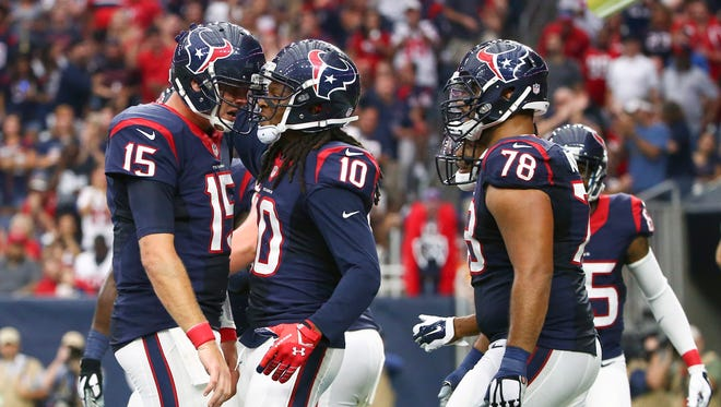 Houston Texans quarterback Ryan Mallett (15) and wide receiver DeAndre Hopkins (10) celebrate a touchdown score during the first quarter against the Tampa Bay Buccaneers at NRG Stadium.