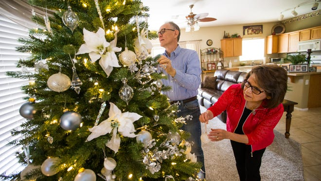 Stretching Your Dollar columnist Bob Blayter and his wife, Maria, were able to get their Christmas tree for free using points at Home Depot; the ornaments were bought during Black Friday sales.