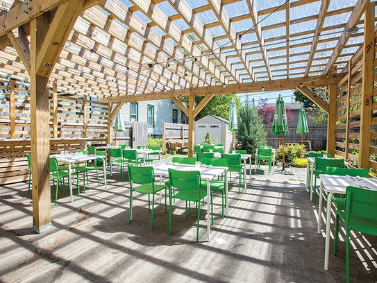 A large deck accomidates outdoor dining.