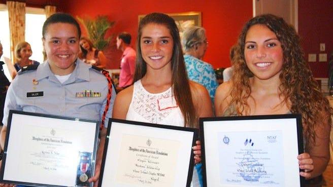 DAR award recipients, from left, are Lely High School JROTC cadet from Marco Island, Kalani Siler; Marco Island Academy senior Meagan Reisinger, and academy sophomore, Chelsea Casabona