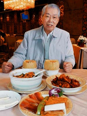 In this 2008 photo, chef Peng Chang-kuei sits at a table in his restaurant Peng's Garden in Taipei, Tawain. The chef, who has been credited with inventing General Tso's chicken, a world-famous Chinese food staple that is not served in China, has died in Taiwan. He was 98.