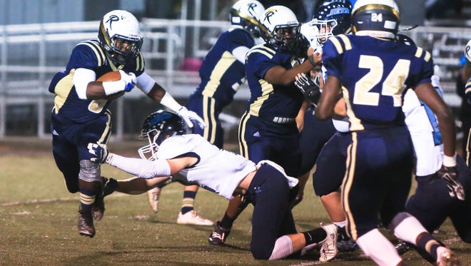 Jerome Pulley carries the ball for Roberson in Friday's 56-6 home win over Enka.