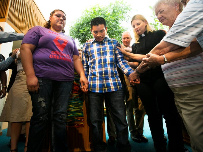 Luis Lopez, 24, prays in Tempe. Lopez is currently in deportation proceedings and is receiving Sanctuary from University Presbyterian Church.