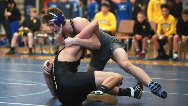 """Enka's Phil Daub wrestles Hunter Trull of Tuscola at the """"Enka Duals'' tournament on Saturday morning at Enka.  Daub pinned Trull in 30 seconds to break the WNC record for most wins with his 206th.Colby Rabon (colbyrabon@gmail.com) January 6, 2017"""