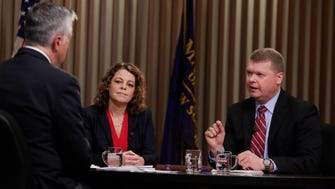Sauk County Circuit Judge Michael Screnock (right) accuses Rebecca Dallet, a Milwaukee County Circuit judge, of wanting to legislate from the bench.