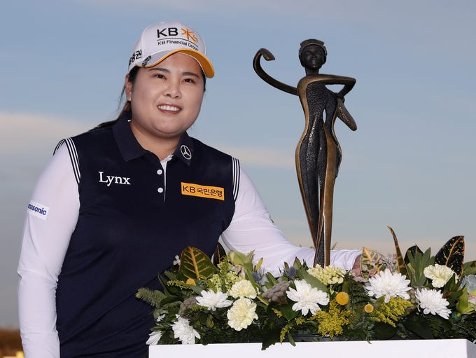Inbee Park of South Korea poses with the trophy after