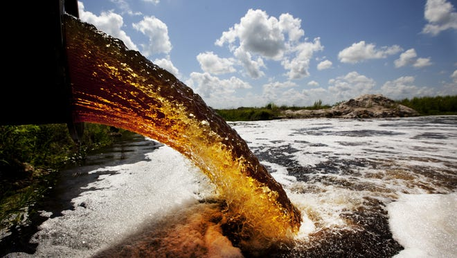 Tannin-filled water from the Calooshatchee River is pumped into the C-43 West Basin Reservoir in Hendry County in 2013. Lee County  Commissioner Frank Mann said Tuesday it will take a long time to repair a century of damage to the historic Everglades.