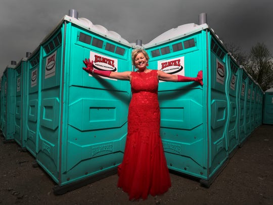In the late '80s Jill Bell was the vice president of marketing for the Kentucky Derby Festival. She was dressed in a ball gown and she had just eaten dinner with her new boyfriend, Tom Bell (who later would become her husband), when she learned that the portable toilets that were supposed to be delivered to the Belvedere were instead delivered to the riverfront. She and her boyfriend, both still dressed in their finery, moved the bathrooms. (Rumpke, the company that provided the equipment for this photo, was not the company involved in the mistake back then.) April 11, 2017