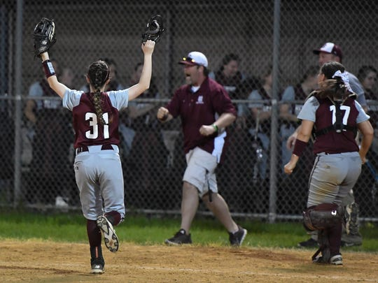 Henderson County celebrates after defeating district rival Webster County 7-5 in a extra inning contest in Dixon Thursday, April 13, 2017.