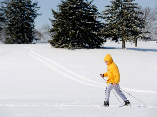Steve Stahley cross-country skis on the McDaniel College golf course, Tuesday, Feb. 17, 2015, in Westminster, Md. Hundreds of thousands of people are without power in the Mid-Atlantic region and the South, after a snow and ice storm that also caused treacherous road conditions