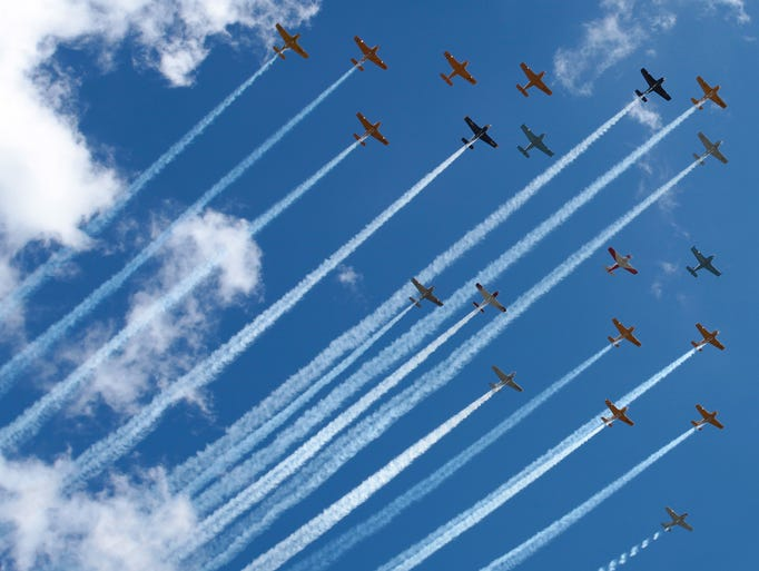 Airplanes from the Warbirds of America fly in formation
