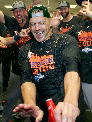 Astros manager A.J. Hinch celebrates with his players