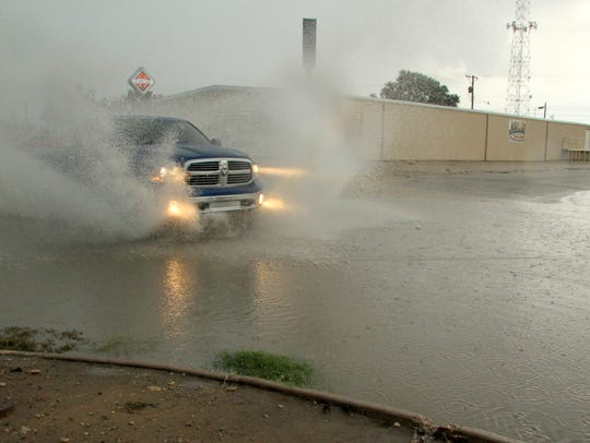 Heavy rains in the area yielded flooded intersections