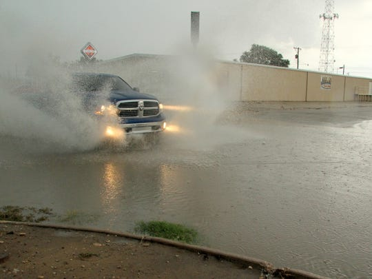 Heavy rains in the area yielded flooded intersections throughout Carlsbad on Tuesday.