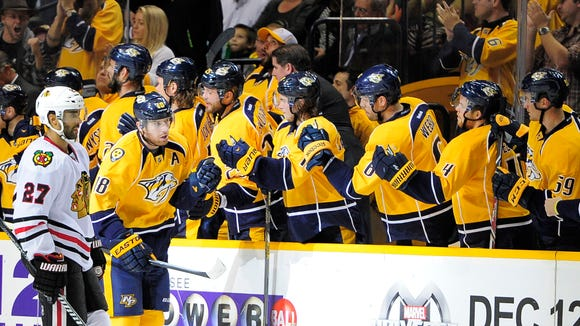 Predators left wing James Neal (18) is congratulated by teammates after his second goal against the Blackhawks during the second period at Bridgestone Arena Thursday Oct. 23, 2014, in Nashville, Tenn.