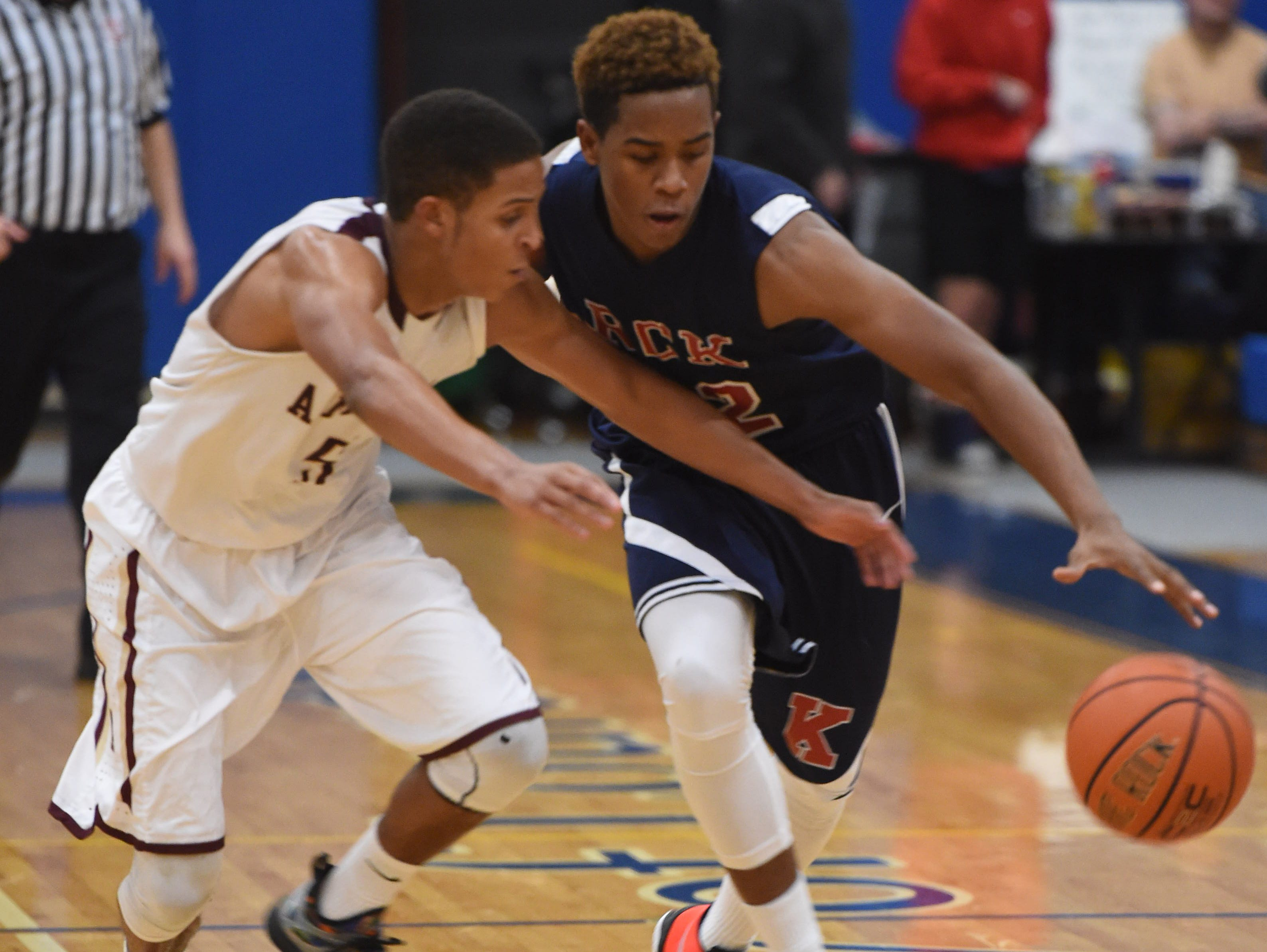 Ketcham's Zaahir Woody keeps the ball away from Arlington's Justin Leigh during the Duane Davis Memorial Holiday Tournament in Poughkeepsie on Wednesday.
