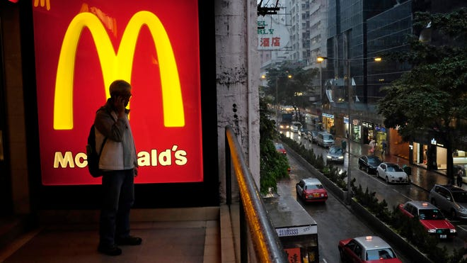 McDonald's ranked last in customer satisfaction in a national survey of patrons of 12 major fast-food chains for the 20th straight year, but one researcher says there's a silver lining: It's closing the gap with the rest of the industry.