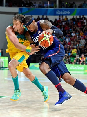 Aug 10, 2016: USA forward Carmelo Anthony (15) drives to the basket against Australia power forward Cameron Bairstow (10) during men's basketball preliminary round in the Rio 2016 Summer Olympic Games at Carioca Arena 1.