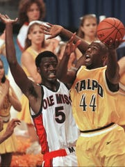 Valparaiso forward Bill Jenkins (44) puts up a shot Friday, March 13, 1998, over Mississippi forward Ansu Sesay (5) during the opening round game of the NCAA Midwest Regional in Oklahoma City. Valparaiso, the 13th seed, upset fourth-seed Mississippi, 70-69, on a last second shot.