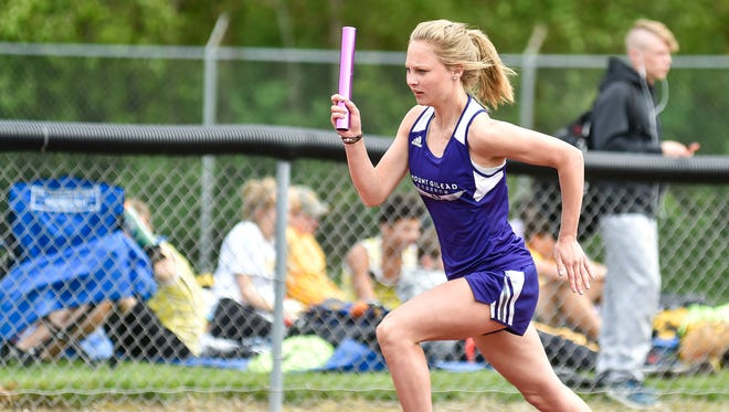 Mount Gilead freshman Jessica Brewer runs a leg of the 4x200-meter relay at the MOAC Track Championships last week at Pleasant.