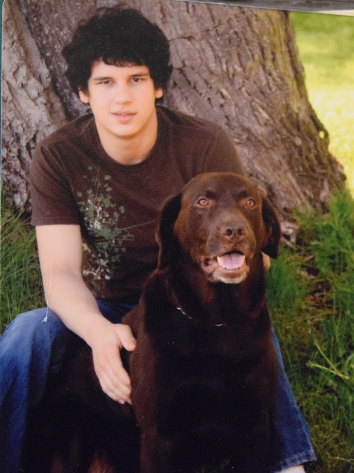 Tysin Gibson with his dog Oakley.