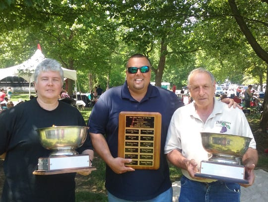 Liz Radski of Hopewell Valley Vineyards (from left), Pennington, was winner of the Governor's Cup for Best Dessert wine for a  2006 Port. She's shown here with Ollie Tomasello of Plagido's Winery, Hammonton, and Frank DiMatteo, DiMatteo Vineyards, Hammonton.