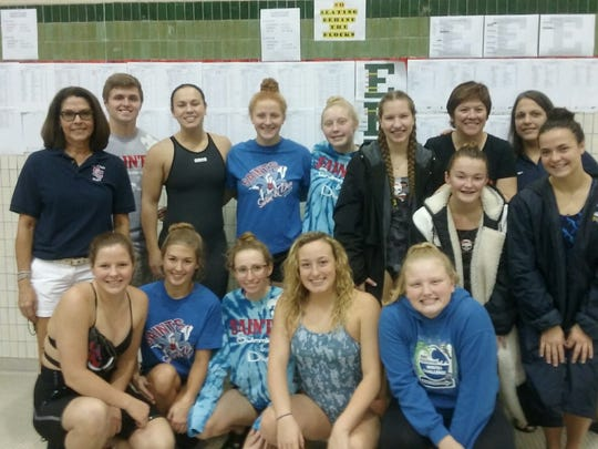 Local swimmers from Marine City, Marysville and St. Clair pose at the Division 3 state finals at Eastern Michigan University.